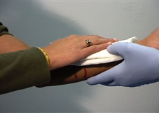 Image of woman treating wound with dressing