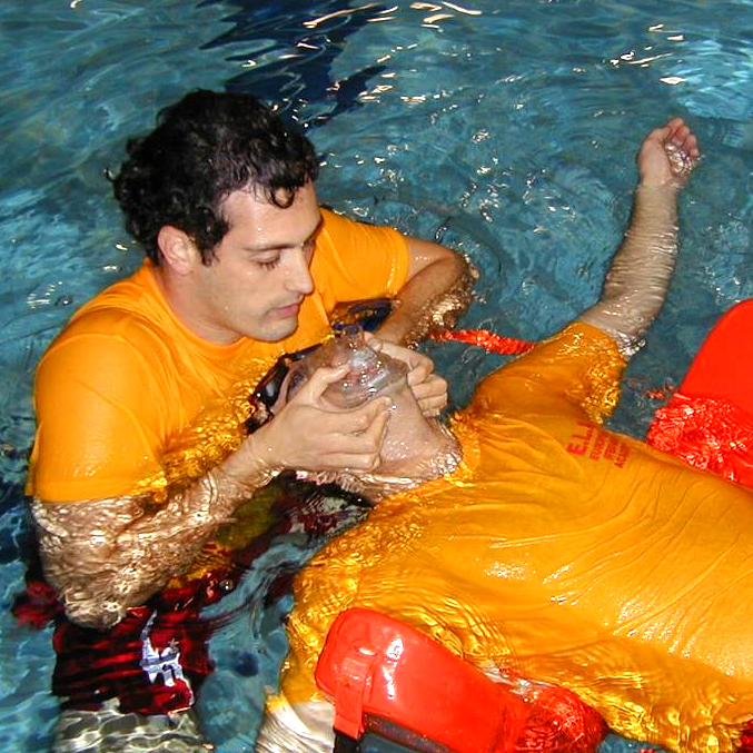 Image of first responsder rescuing an unconscious casualty in the water
