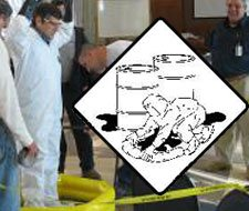 Image of industrial spill and HAZWOPER accidental release caution sign.